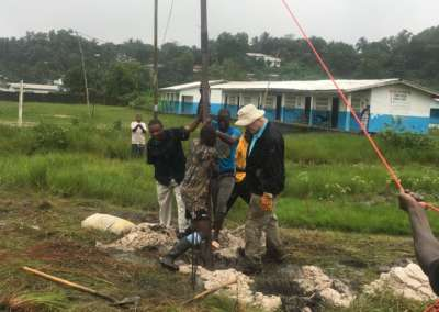 Securing Cross in the pouring rain