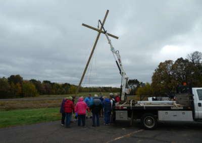 Group prayer before inserting Cross