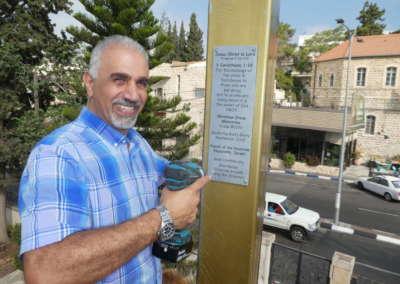 Pastor Nizar securing plaque