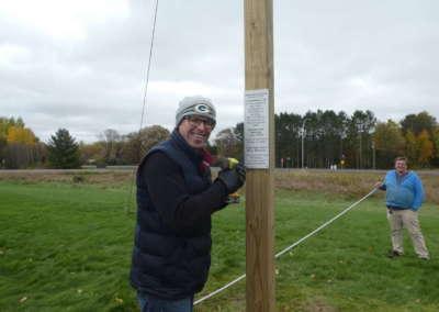 Pastor Steve attaching plaque